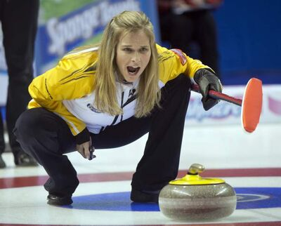 Manitoba skip Jennifer Jones yells instructions during curling action against PEI at the Scotties Tournament of Hearts in Kingston, Ont., on Saturday.