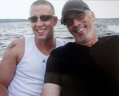 PHIL HOSSACK / WINNIPEG FREE PRESS FILES</p><p>CBC Sports broadcaster Scott Oake, right, poses with his son Bruce in a family photo. The Oake family is in discussions with the province and city officials in an attempt to build a residential addictions treatment facility in honour of Bruce, who died of a drug overdose in 2011.</p>