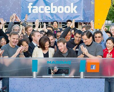 facebook handout photoFacebook CEO Mark Zuckerberg, centre, rings the opening bell of the Nasdaq stock market May 18 as Facebook stock went on sale for the first time.