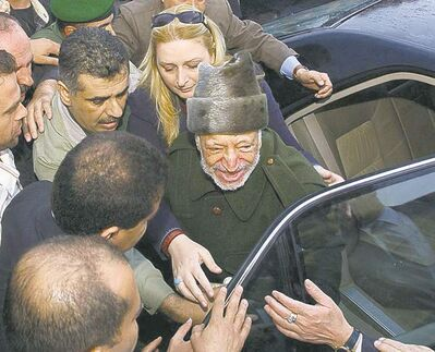 HUSSEIN HUSSEIN / THE ASSOCIATED PRESS ARCHIVESPalestinian leader Yasser Arafat says goodbye to aides as he leaves Ramallah to be treated in France for the mysterious illness that took his life soon after.