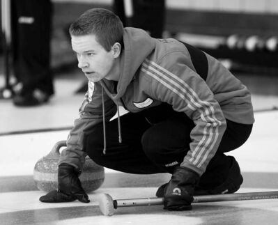 Photos by joe bryksa / winnipeg free pressCole Peters of West St. Paul follows his shot intently at Deer Lodge Curling Club Friday night (above).