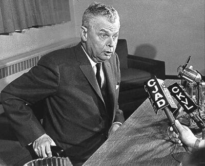 John Diefenbaker addresses the press in 1964.