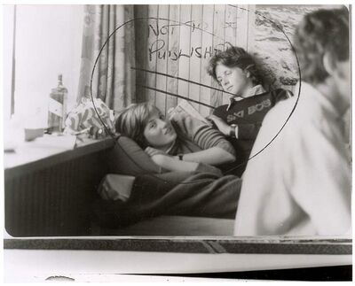 """This image provided by RR Auction shows a photograph marked """"not to be published"""" of a teenage Diana Spencer before she became Princess of Wales, with a young friend seated beside her. The boy has been identified by a British newspaper as Adam Russell, great-grandson of former British prime minister Stanley Baldwin."""