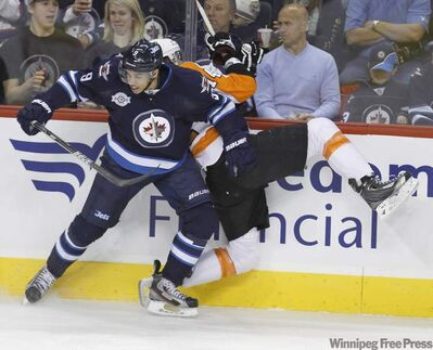 Winnipeg Jets' Evander Kane hits Philadelphia Flyers' Tomas Fleischmann during the first period Saturday at the MTS Centre.