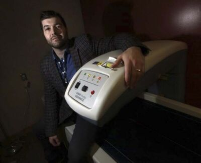 PHIL HOSSACK / WINNIPEG FREE PRESS</p><p>Dylan Mac Kay with a DXA body scanner at the Richardson Centre for Functional Foods and Nutraceuticals.</p>