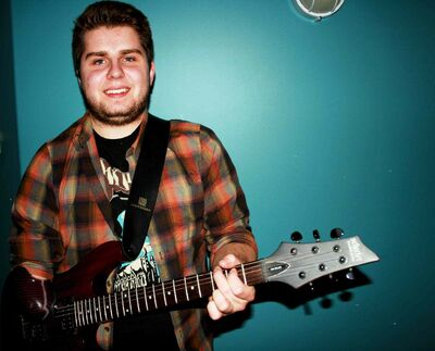 East Kildonan resident Connor Nykyforak is shown with a specially-made prosthetic he uses to play guitar.