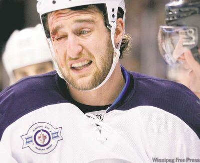 Tanner Glass and his  Winnipeg teammates have taken their lumps during the first month of 2012.