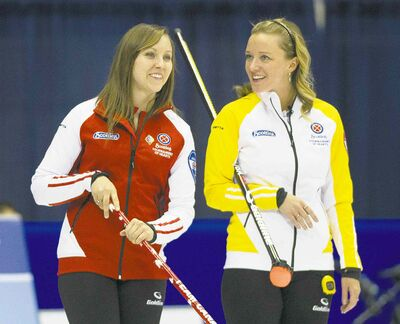 Graham Hughes / the canadian pressTeam Canada skip Rachel Homan (left) and Manitoba skip Chelsea Carey share some humour before their draw at the Scotties Tournament of Hearts Saturday.