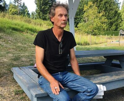 "Alan Schmegelsky, father of Bryer Schmegelsky, poses for a photo during an interview with The Canadian Press in Mill Bay B.C. on Wednesday, July 24, 2019. The father of a suspect in the deaths of three people in northern British Columbia says his son is in ""very serious pain"" and he expects a nationwide manhunt will end in the young man's death. THE CANADIAN PRESS/Laura Kane"