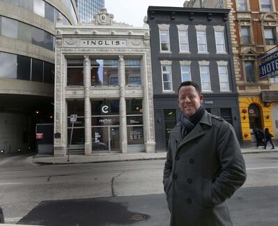WAYNE GLOWACKI / WINNIPEG FREE PRESS</p><p>John McDonald, pres. & CEO Metric Marketing, poses in front of the historic Inglis building at 291 Garry St. </p></p>
