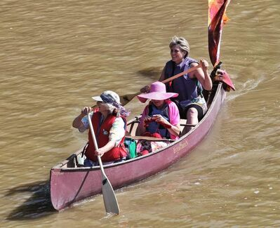 Margaret Brook (left), Leeanne Penner (knitting) and Margerit Roger take part in Paddle to the Park.