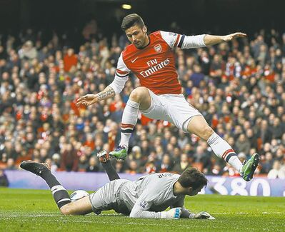 Arsenal will be without its second-leading scorer, striker Olivier Giroud (top), for three matches.