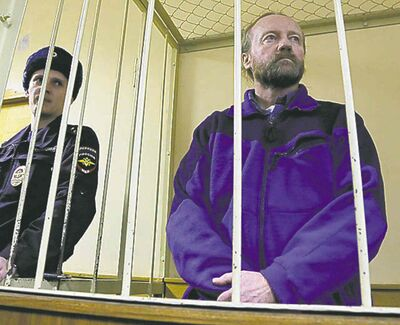 Dmitry Lovetsky / THE ASSOCIATED PRESS FILESGreenpeace activist Paul Ruzycki stands in a defendant�s cage during hearings in November.