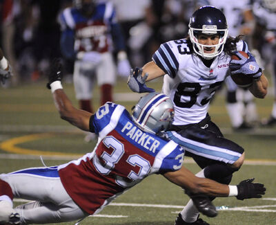Toronto Argonauts' Julian Feoli-Gudino escapes a tackle attempt by Montreal Alouettes' Keynan Parker during a game on June 20, 2013 in Toronto. The Bombers announced they signed Feoli-Gudino today.