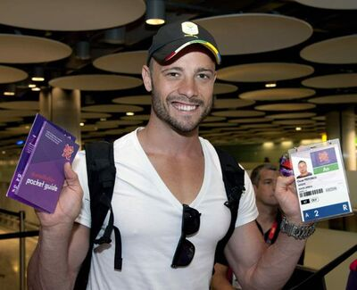 South African athlete Oscar Pistorius arrives at Heathrow Airport, London from his training camp in Venice, Italy Friday, July 27. (AP Photo)