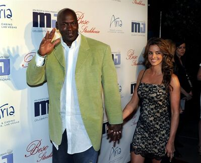 In this photo provided by the Las Vegas News Bureau, basketball great Michael Jordan and his girlfriend Yvette Prieto arrive for a celebrity dinner at Beso inside Crystals in City Center in Las Vegas. The former NBA star and Charlotte Bobcats owner appeared at the main Palm Beach County courthouse Thursday morning, March 7, 2013 to apply for a marriage license, according to Kathy Burstein, a spokeswoman for the clerk's office. (AP Photo/Las Vegas News Bureau, Brian Jones)