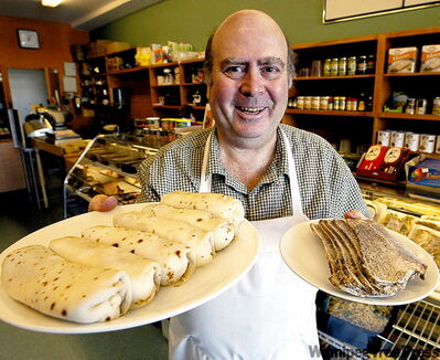 Myer's owner Danny Weinberg offers a welcoming platter of cheese blintzes and a plate of roast brisket at his River Heights treasure trove of Yiddish delights.