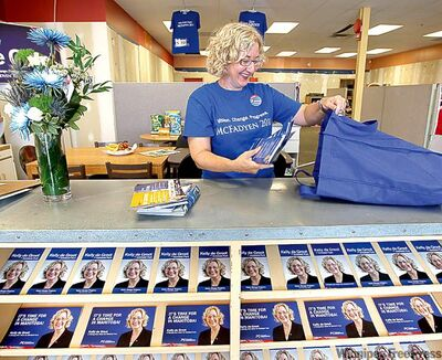 Conservative Kelly de Groot packs her bag with campaign literature before heading out to knock on doors.