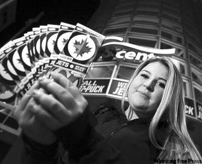 Danika Gagné holds worthless Jets tickets.