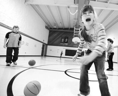 Latisha Smith and her classmates play ball at Reynolds Community School, the province's smallest public school.
