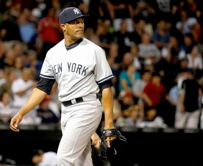 New York Yankees relief pitcher Mariano Rivera looks at the scoreboard after the ninth inning of a baseball game against the Chicago White Sox Wednesday, Aug. 7, 2013, in Chicago. Rivera gave up the tying run on a single by Adam Dunn scoring Gordon Beckham. (AP Photo/Charles Rex Arbogast)