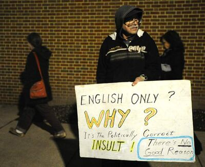 Paul Crone protests next to the County Office Building in Westminster, Md. Tuesday night.