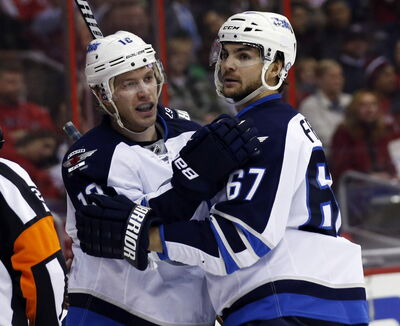 Winnipeg Jets' centre Bryan Little (18) celebrates his goal with right wing Michael Frolik (67), during the first period of an NHL hockey game against the Washington Capitals on Thursday.