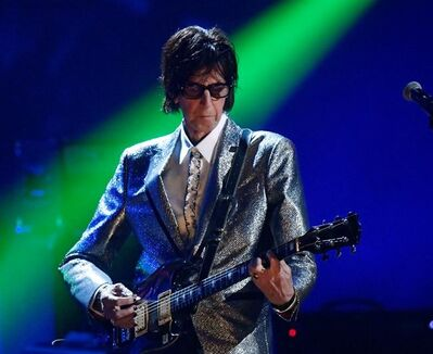 FILE - In this April 14, 2018, file photo, Ric Ocasek, from the Cars, performs during the Rock and Roll Hall of Fame Induction ceremony in Cleveland. Ocasek, famed frontman for The Cars rock band, has been found dead in a New York City apartment. The New York City police department said officers responding to a 911 call found the 75-year-old Ocasek on Sunday, Sept. 15, 2019. (AP Photo/David Richard, File)
