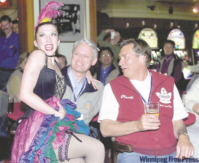 Doer visits a Dawson City casino during Western Premiers conference in June 2002. A Can Can girl is sitting on B.C. Premier Gordon Campbell's knee.