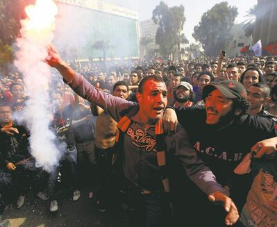 Khalil Hamra / The Associated PressEgyptian soccer fans of Al-Ahly celebrate a court verdict that returned 21 death penalties in last year�s soccer violence.