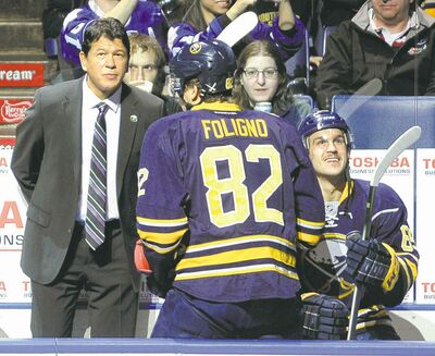 gary wiepert / the associated pressNew Sabres head coach Ted Nolan takes his place behind the bench before Friday�s game against the Maple Leafs.