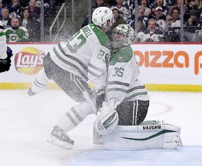 Dallas Stars' Esa Lindell collides with goaltender Anton Khudobin during the second period.