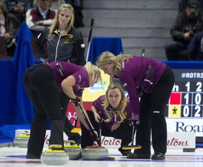 THE CANADIAN PRESS/Adrian Wyld</p><p>Team Jones skip Jennifer Jones, from Winnipeg, MB. looks on as skip Chelsea Carey, from Calgary, Alta. third Cathy Overton-Clapham (right) and lead Laine Peters (left) watch a shot enter the house Wednesday in Ottawa. </p>