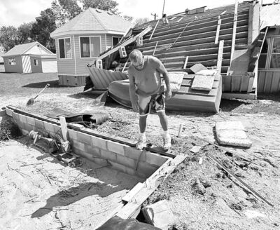JOE BRYKSA / WINNIPEG FREE PRESS  Briant Fransoo surveys his boathouse that was ripped from its foundation and thrown against his cottage at Twin Lakes Beach.
