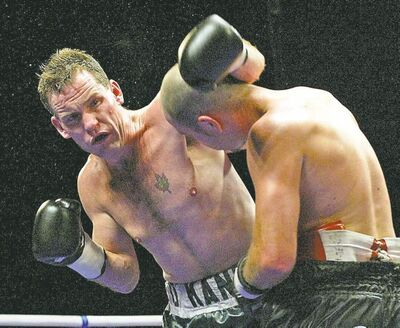 ken gigliotti / winnipeg free press archives  Peter O'Kane (left) takes the measure of Francis Doiron in a December 2002 bout.