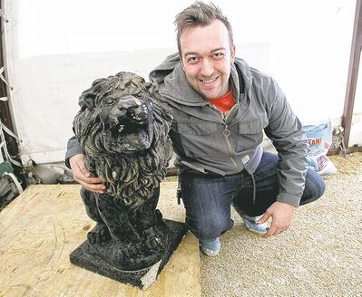 MIKE DEAL / WINNIPEG FREE PRESSNick Rogocki with the marble lion he bought for $60 at the police auction Sunday.