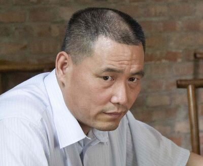 """In this June 20, 2012 file photo, human rights lawyer Pu Zhiqiang works near his computer in Beijing. Chinese police have detained Pu since June 13 in a government clampdown on activists ahead of the 25th anniversary of the Tiananmen Square military suppression of protesters, an attorney said Thursday, May 15, 2014. Pu's aide, Qu Zhenhong, who is also his niece, was recently detained by Beijing police on suspicion of """"illegally obtaining personal information,"""" said Zhang Sizhi, a veteran rights lawyer who is Pu's attorney."""