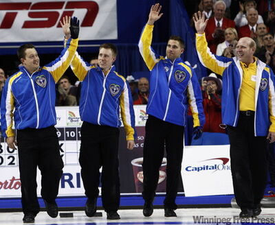 Alberta lead Ben Heber, (left to right) second Marc Kennedy, third John Morris and skip Kevin Martin wave to the crowd after defeating Manitoba 10-4.