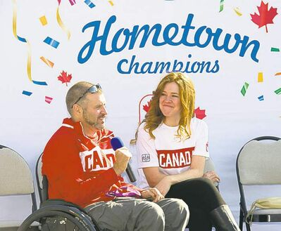 DAVID LIPNOWSKI / WINNIPEG FREE PRESSNiverville�s Paralymic multi-medallist Jared Funk and summer and winter Olympic medallist Clara Hughes discuss their glory days at the Royal Bank�s Hometown Champions event in Sage Creek on Saturday afternoon.