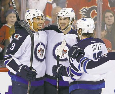 larry macdougal / the canadian press filesThe Winnipeg Jets have filed for salary arbitration with right-winger Michael Frolik (centre), who will likely be signed.