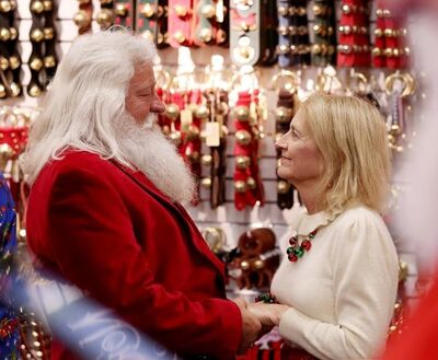 In this Wednesday, May 15, 2019 photo, Santa Dennis Hoffman and his wife Ellen from Florida take part in the ceremony as dozens of Santas visiting Alaska stop by the Santa Claus House in North Pole, Alaska, renew their wedding vows. It's the perfect time of year for a wedding, and what better place for Santa to get married than North Pole, where it's Christmas even in May? Oh, this North Pole is a suburb of Fairbanks, not that geographic or magnetic point at the top of the world. (Eric Engman/News-Miner via AP)