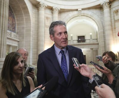 RUTH BONNEVILLE / WINNIPEG FREE PRESS</p><p>Premier Brian Pallister responds to questions from the media during scrum after the last session in the house before summer break at the Manitoba Legislative Building, Thursday.</p>