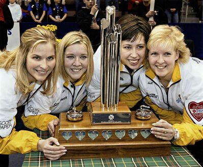 Manitoba skip Jennifer Jones, third Cathy Overton-Clapham, second Jill Officer and lead Cathy Gauthier, left to right, pose with their trophy  after winning the Scott Tournament of Hearts women's curling championship  in 2005.