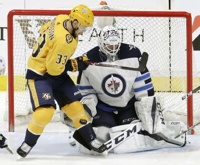 (AP Photo/Mark Humphrey)</p><p>Nashville Predators left wing Viktor Arvidsson tries to deflect the puck against Winnipeg Jets goalie Michael Hutchinson in the first period of an NHL hockey game Tuesday in Nashville.</p>