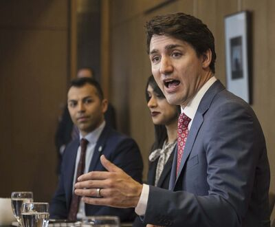 Christopher Katsarov / The Canadian Press Files</p><p>Prime Minister Justin Trudeau appears alongside Liberal MPs (from left) Marwan Tabbara and Bardish Chagger on April 17, 2019. After being charged with multiple criminal offences, Tabbara stepped down from the Liberal caucus but did not resign his seat.</p>