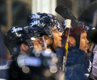Evander Kane waits his turn on the bench Friday.