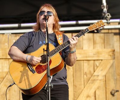 Emily Sailers of the Indigo Girls plays on the main stage of the Winnipeg Folk Festival at Birds Hill Provincial Park Thursday.