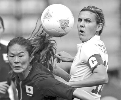 Ryan Remiorz / The Canadian PressJapan�s Homare Sawa (left) and Canada�s Christine Sinclair go after a loose ball in their contest in Coventry, England.