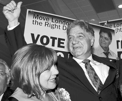 London, Ontario, mayoralty candidate Joe Fontana and wife Vicky react to election results coming in that show Fontana in a virtual dead-heat with incumbent Anne Marie DeCicco-Best in the municipal election in London, Ontario, Monday, October 25, 2010. THE CANADIAN PRESS/Dave Chidley