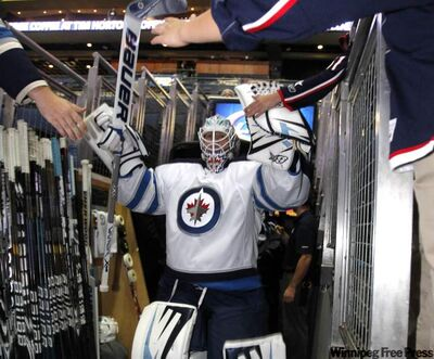 Chris Mason leads the Winnipeg Jets on to the ice at Nationwide Arena in Columbus, Ohio, Tuesday. The Jets take on the Columbus Blue Jackets in a split-squad pre-season game as the Jets return to the NHL after a lengthy absence.